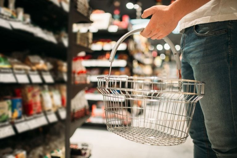 male-customer-with-empty-basket-in-supermarket-CXANS56-768x513